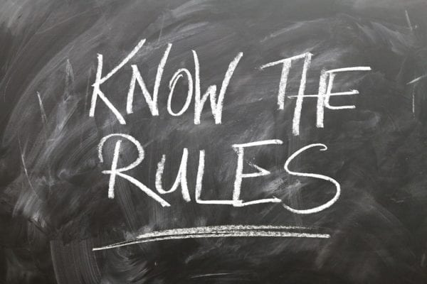 """Black board with writings """"Know the Rules"""""""