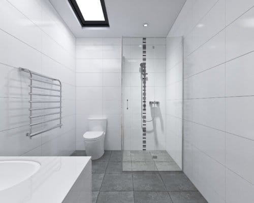 Glass door shower room, toilet bowl, steel rack with gray colored tiles.